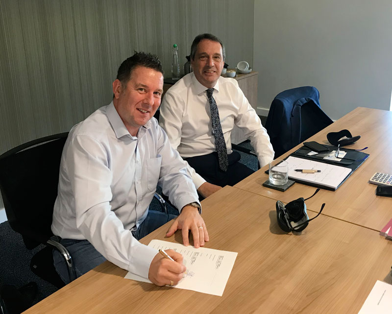 MD Richard Potts with Phil Nicholls of WilkesTranter accountants signing the SPA at Higgs & Sons solicitors.